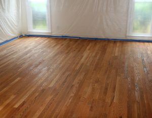 A room with hardwood floors being refinished.